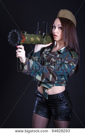 Portrait Of A Woman In A Military Uniform With A Grenade Launcher