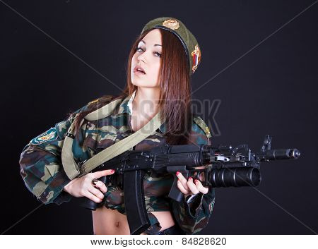 Beautiful Young Woman In A Military Uniform With An Assault Rifle