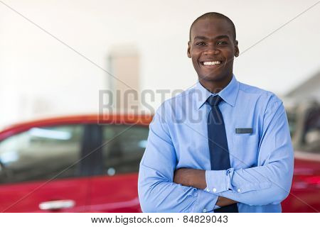 handsome african man working at car dealership