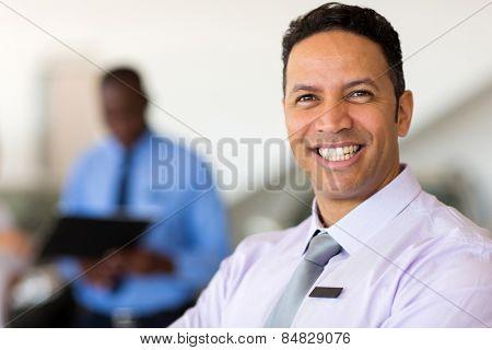 close up portrait of mid age vehicle dealer
