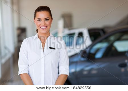 gorgeous woman working at vehicle showroom