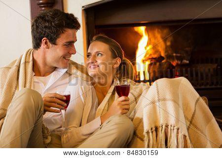 beautiful couple spend romantic evening drinking wine