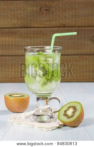Kiwi refreshing drink on a wooden table.