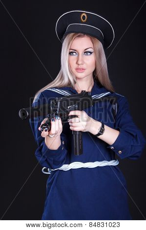 Beautiful Young Woman In A Marine Uniform With A Submachine Gun