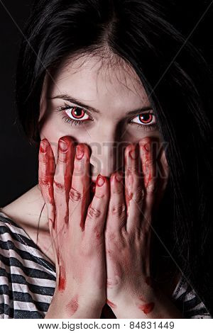 Woman With Red Eyes And Bloody Palms On Her Face