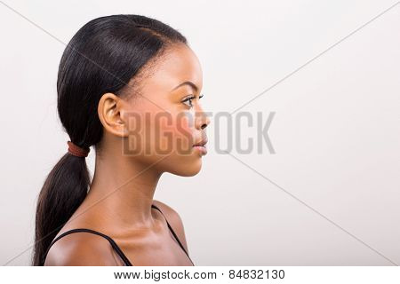 side view of pretty african woman on plain background