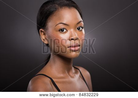 beautiful young afro american woman with clear skin and make up