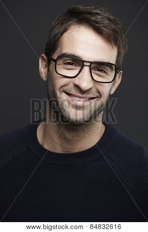 Portrait of mid adult man wearing glasses smiling