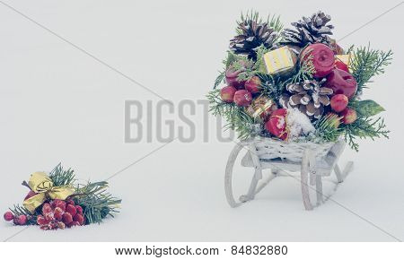 Wooden Toy Sledge With Christmas Decoration On Snowy Background