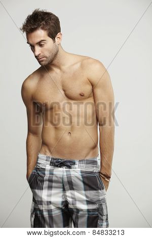 Mid adult man in shorts studio