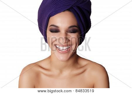 Close-up Portrait Of A Beautiful Dark Skinned Woman Who Smiles White Background