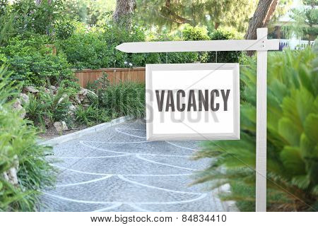 Signboard with text Vacancy near hotel