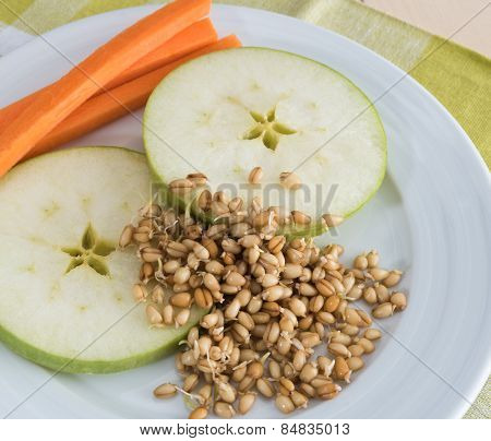 Apple, carrot and wheat sprouts