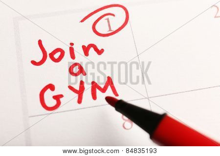 Written plan Join Gym on calendar page background