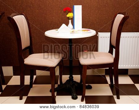 Cozy Table And Two Chairs In The Cafe.