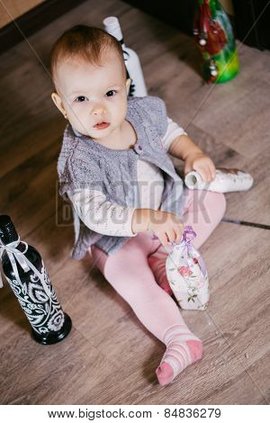 child has fun sitting bottle