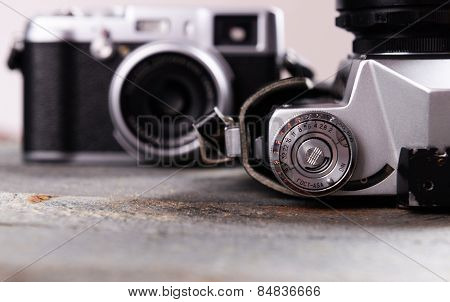 Old retro camera on rustic wooden planks background