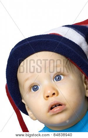 Baby boy in winter hat against white background
