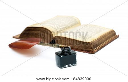 Inkwell, Pen And An Old Open Book Isolated On White Background Close-up