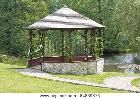 Sone wedding gazebo decorated with flowers and ribbons