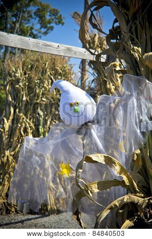 A funny ghost puppet in amongst corn as part of halloween festival