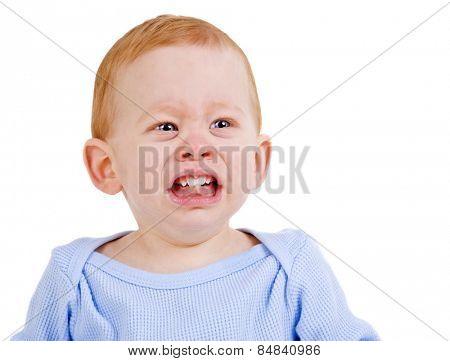 Sad baby boy crying with teething pain