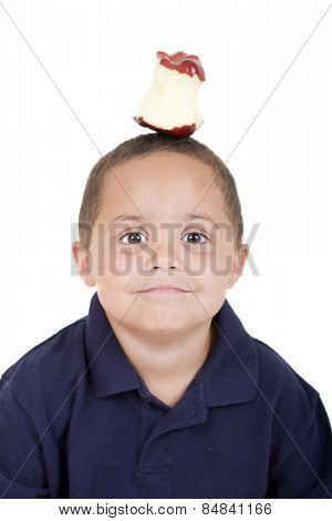 Young boy with half eaten apple on his head