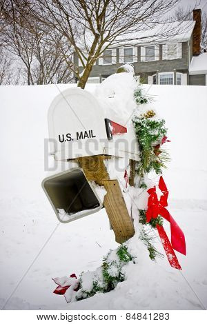 Mailbox with Christmas decorations covered in snow