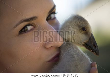 Young Girl With Spring Duckling