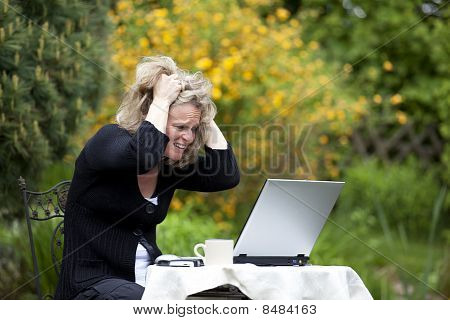 blond woman tearing her hair