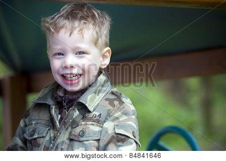 Happy boy smiling at camera