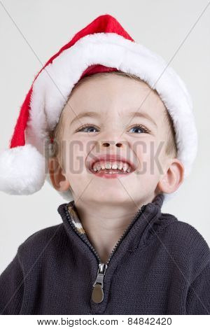 Handsome baby boy wearing a santa hat portrait