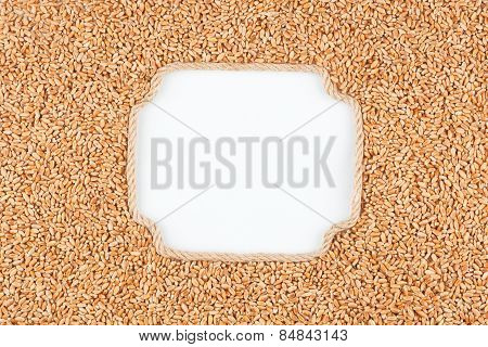 Figured Frame Made Of Rope With  Wheat  Grains  Lying On A White Background