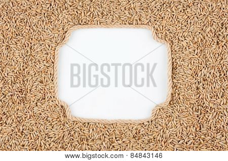 Figured Frame Made Of Rope With  Rye  Grains  Lying On A White Background