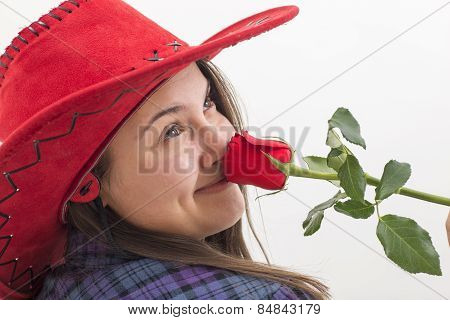 A Young Woman Smelling A Rose