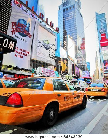 NEW YORK - DECEMBER 29: Yellow cabs speed through Times Square landmark during run up preparations for New Years Eve event on Dec 29, 2009 in New York, NY, USA.