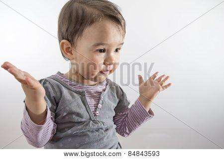 Little Girl Expressing Amazement Isolated On White Background