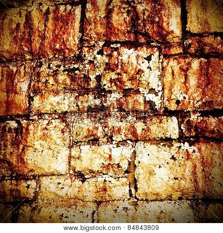 Abstract grunge brick wall background with flaking white paint
