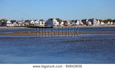 Waterside side colonial style houses on the beach