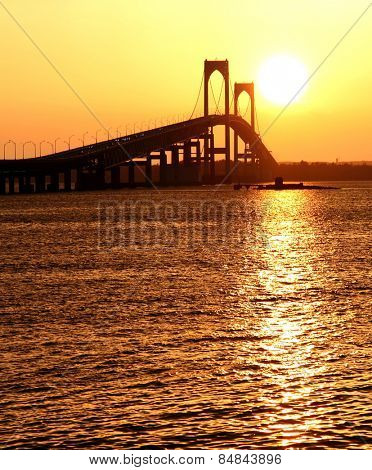 Beautiful sunset over Claiborne Pell Bridge in Newport, Rhode Island