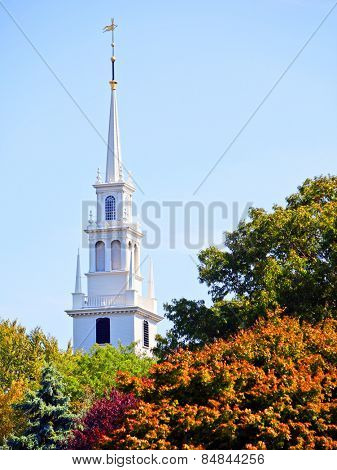 White new england style colonial church spire in fall