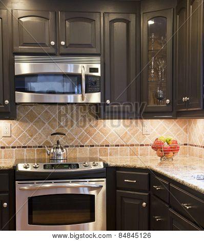 Modern kitchen with dark brown wooden cabinets