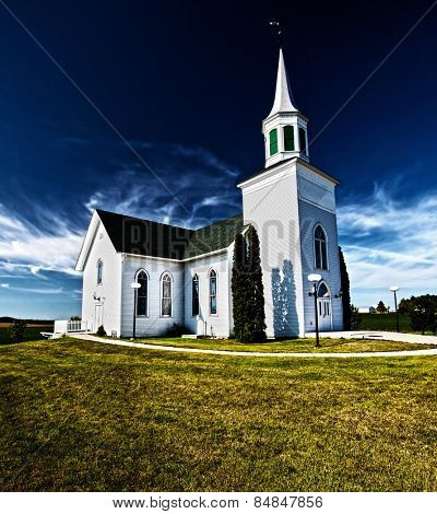 Traditional American white church in the countryside