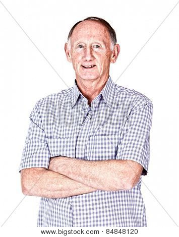 Senior man smiling with arms folded on white background
