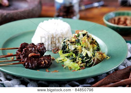 Indonesian Cuisine Goat Satai Served With Indonesian Salad And Rice