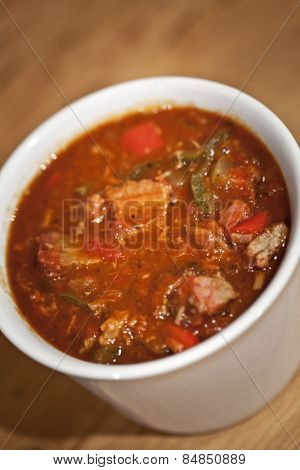 American brisket chili in a white bowl