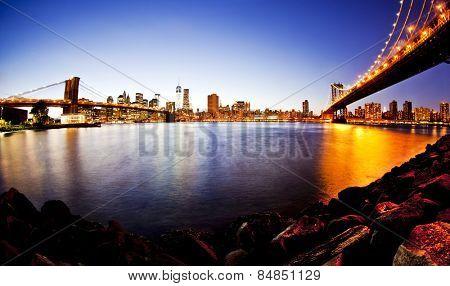 Manhattan Bridge and Brooklyn Bridge with Manhattan skyline At Night