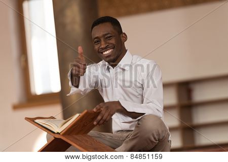 Black African Muslim Man Showing Thumbs Up