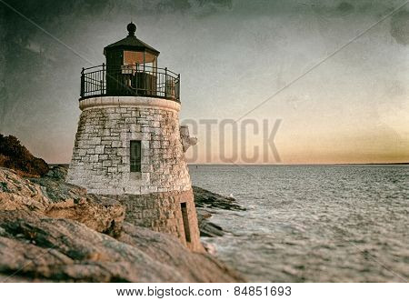 Beautiful old lighthouse on rocks at sunset vintage look