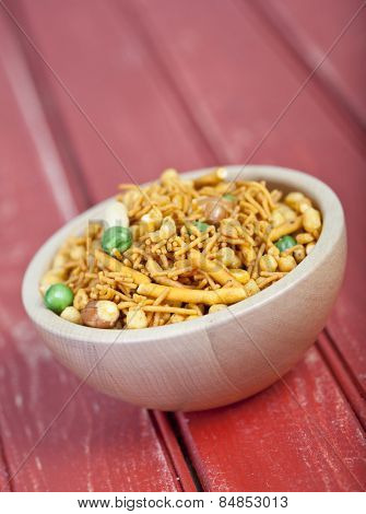 Fresh Chanachur or bombay mix in a wooden bowl